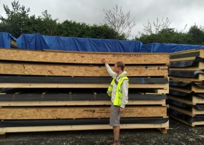 Sam on site checking the timber frame panels for our factory