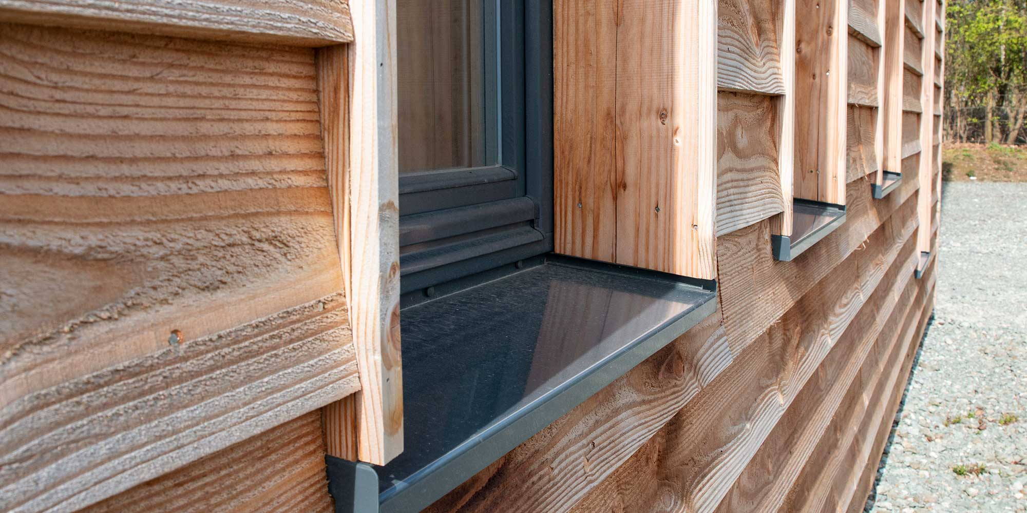 Green Building Store Windows with Timber cladding