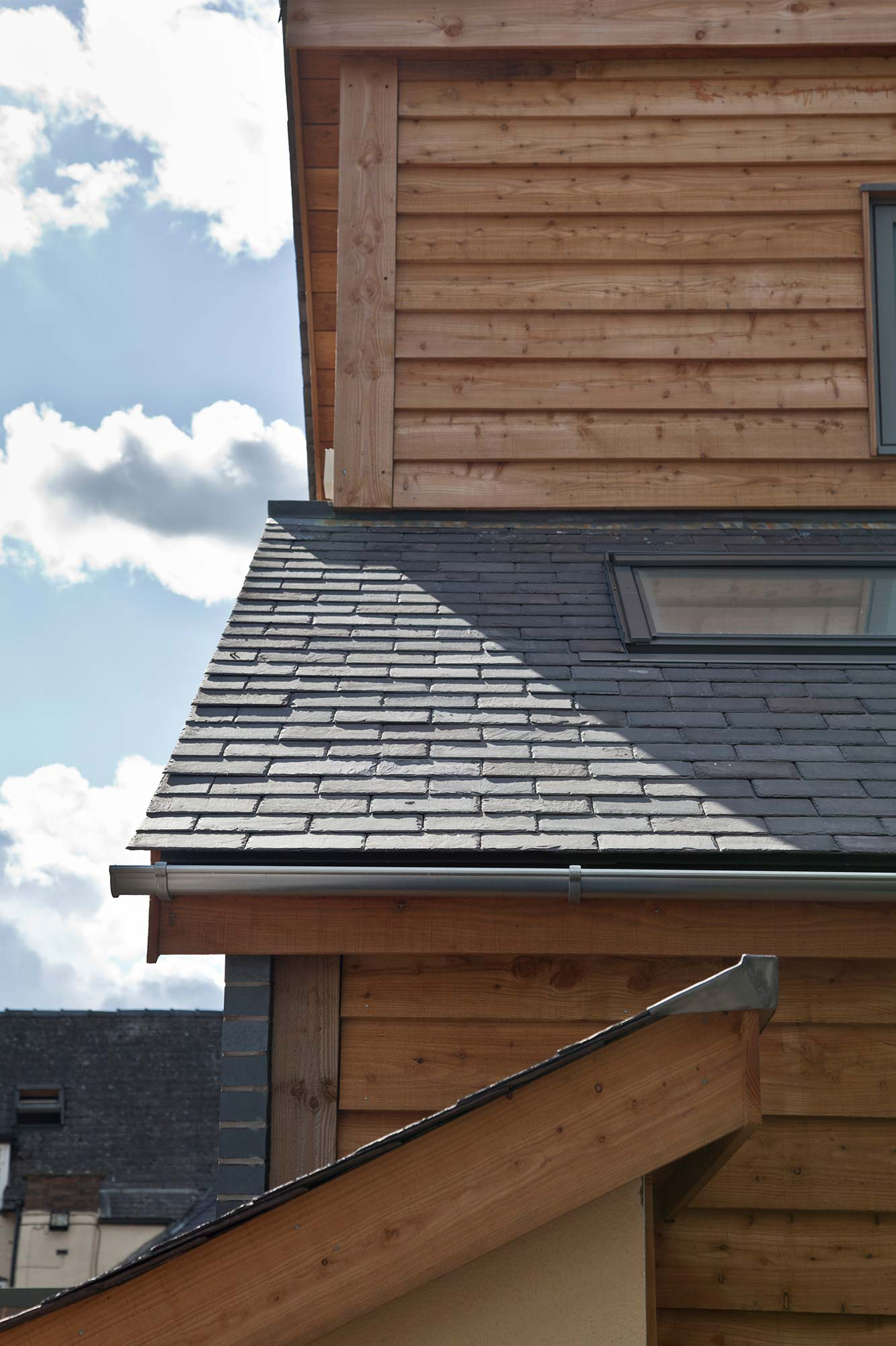 Timber cladding and slate roof